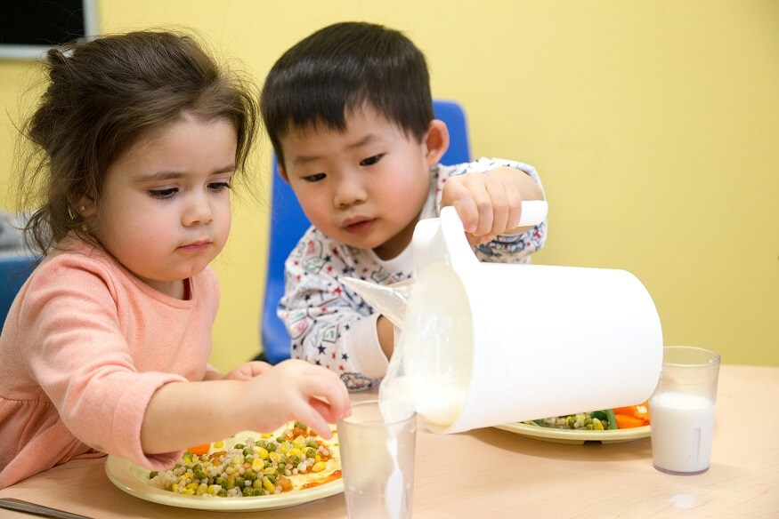 Toddler enjoying healthy meal