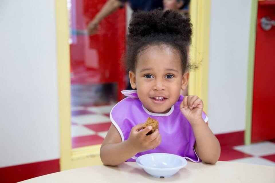 Toddler enjoying healthy snack
