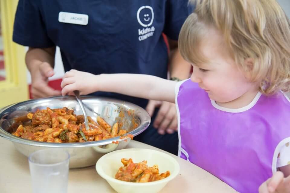 Toddler enjoying healthy meal