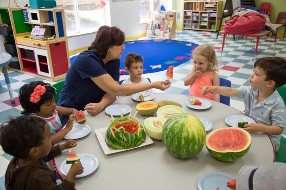 Early Childhood Educator teaching kids about watermelon
