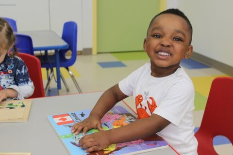 Preschooler learning about North America at Daycare centre