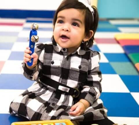 Child making music at daycare