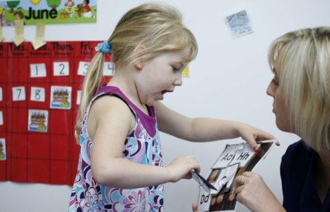 Children learning at daycare with teachers