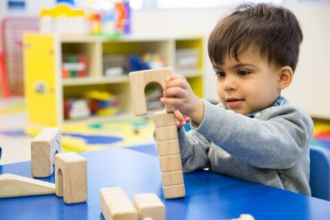 child building at daycare