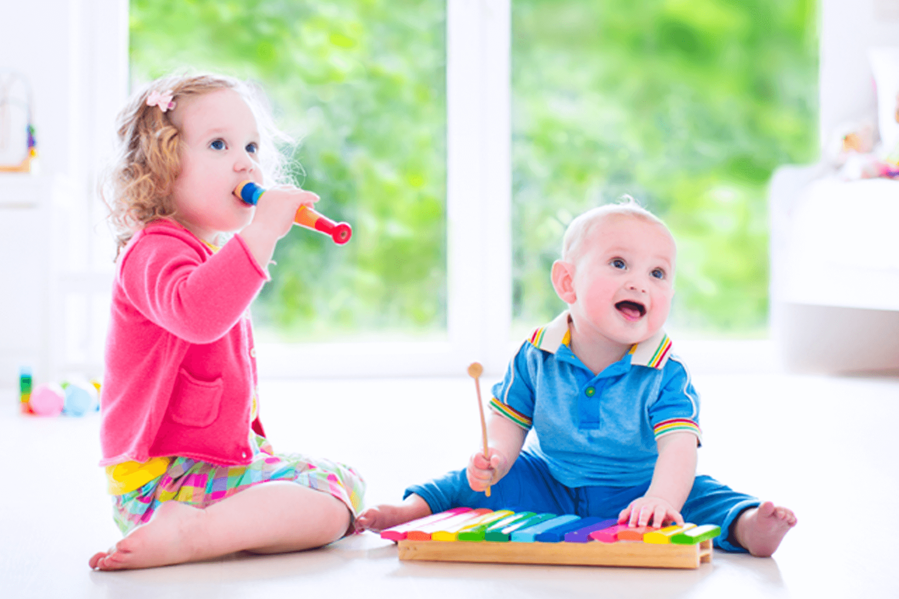 Siblings playing with music - Montessori daycare program